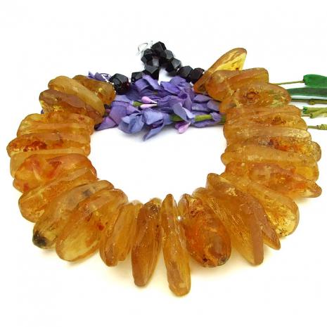 Golden amber and red garnet boho necklace.