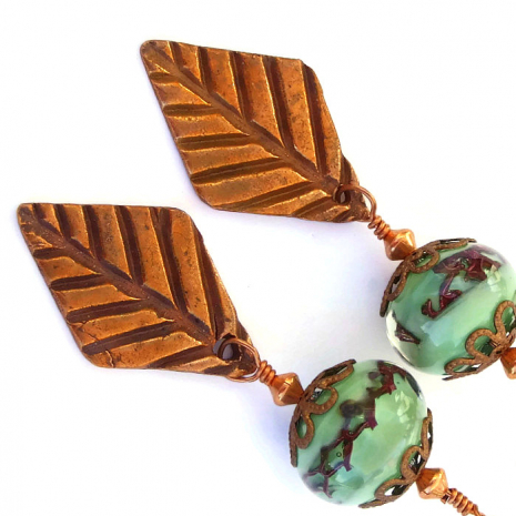 Beautiful together: copper leaf charms and green lampwork glass beads.