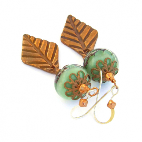 Copper filigree caps are lovely with the lampwork beads used in the earrings.
