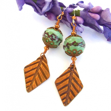 Unique artisan designed copper leaf and green lampwork earrings.