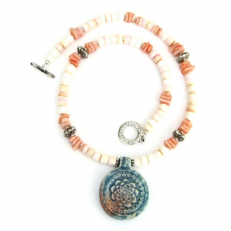 Handmade lotus flower ceramic pendant necklace with pale pink shell beads.