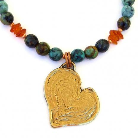 back side of dog paw print heart pendant