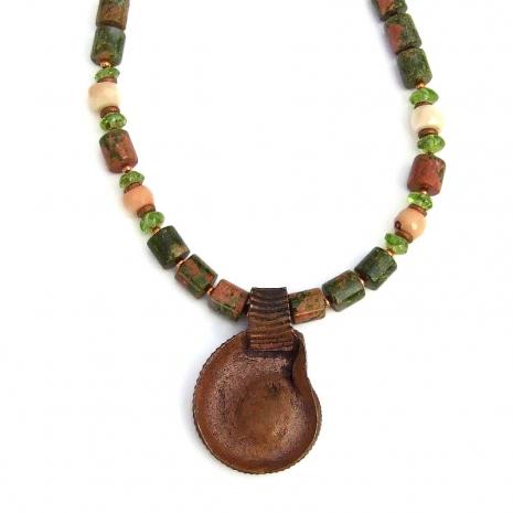 backside of copper ammonite pendant