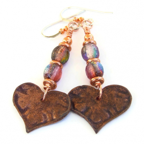 backside of hand painted copper heart earrings