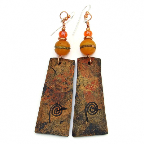backside of klimt inspired polymer clay dangles with artists mark