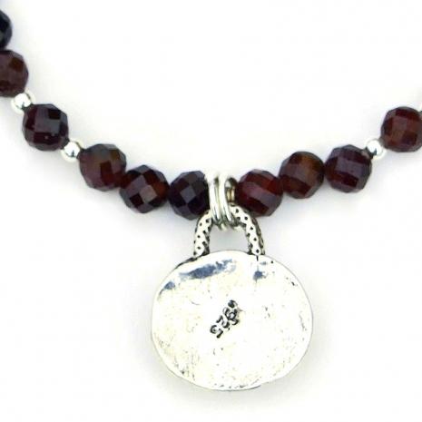 backside of sterling cross heart pendant