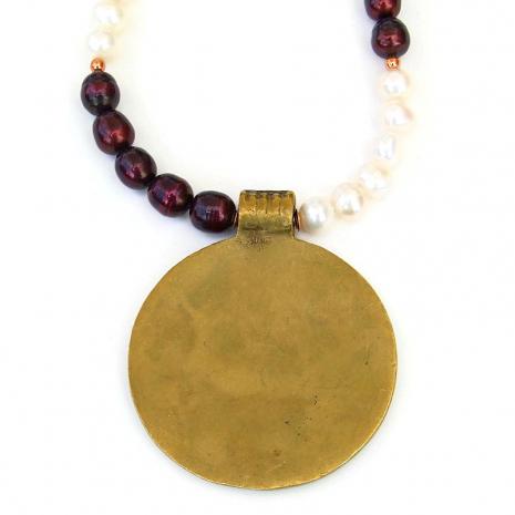 backside of vintage brass cross pendant