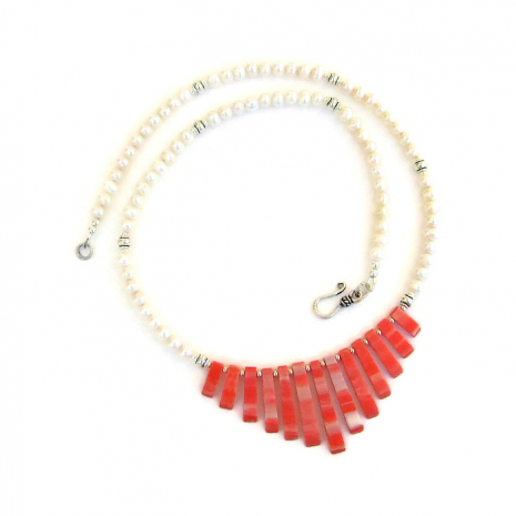The perfect shell fan and pearl necklace for the woman who loves the beach.