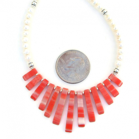 Unique artisan orange shell fan and white pearl necklace.