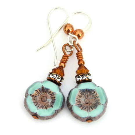Mint green pansy flower earrings with crystals.