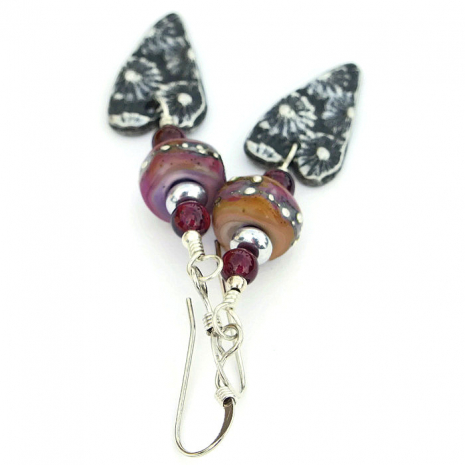 Handmade fashion dangle earrings with flower charms and lampwork beads.