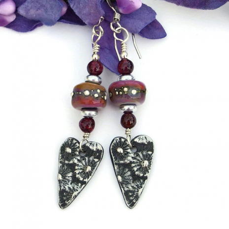 Artisan handmade daisy pewter charms, lampwork and garnet earrings.