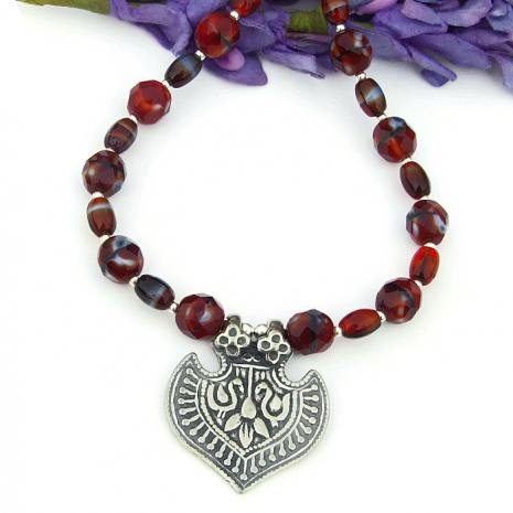 one of a kind ibis and lotus flower necklace