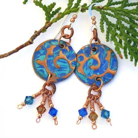 Copper disc earrings.