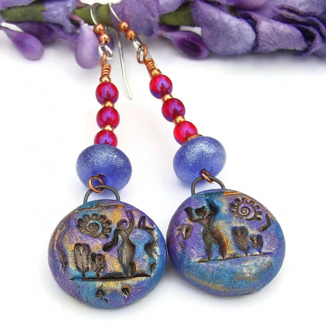 blue purple and gold hieroglyph earrings