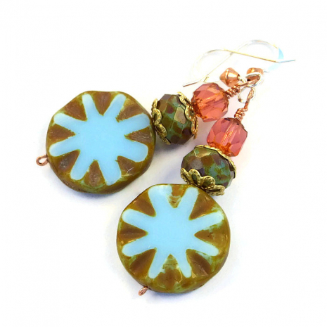 The star burst Czech glass beads have an olive green Picasso finish.