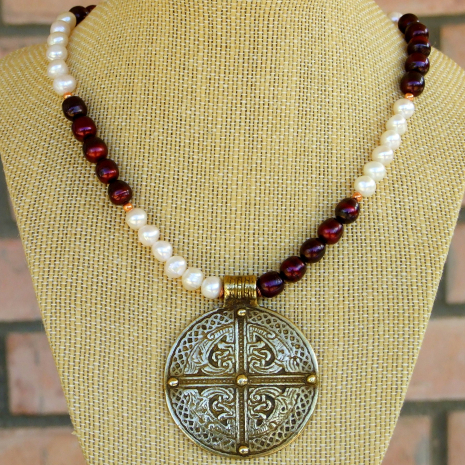 brass cross pendant jewelry with maroon and white pearls