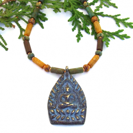 brass shakyamuni buddha pendant necklace with earthy czech glass