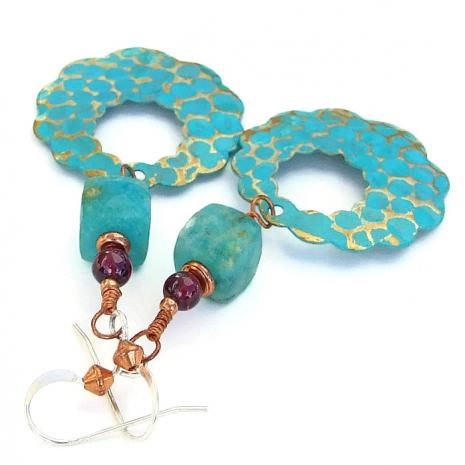 Artisan handmade scalloped hoop earrings with glowing gemstones.