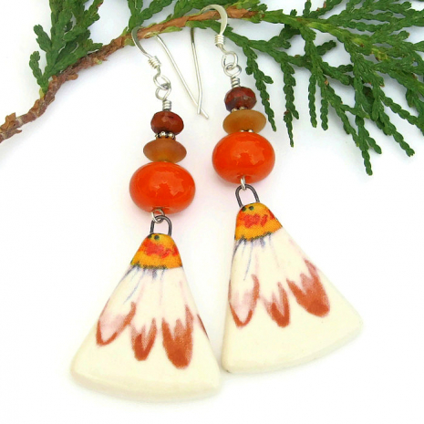 daisy jewelry with orange lampwork beads