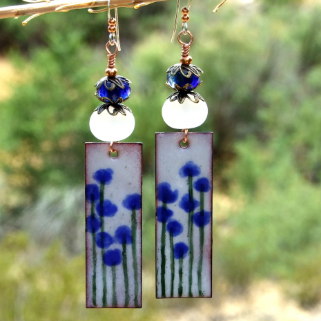enamel blue flower dangle earrings glowing lampwork beads