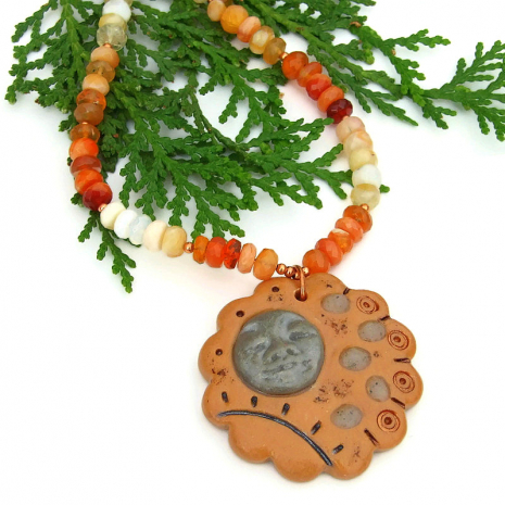 face pendant jewelry with orange mexican fire opal