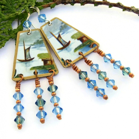Vintage tin earrings with boat design.