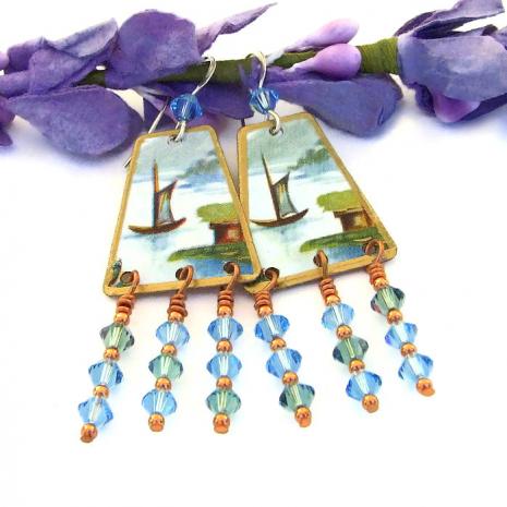 Vintage tea tin and Swarovski crystal earrings.