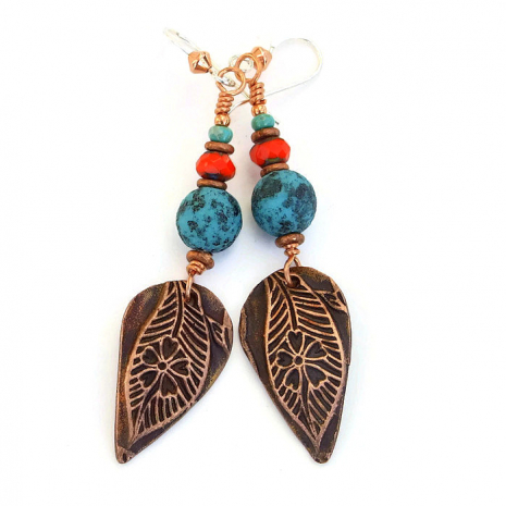Turquoise and orange earrings.