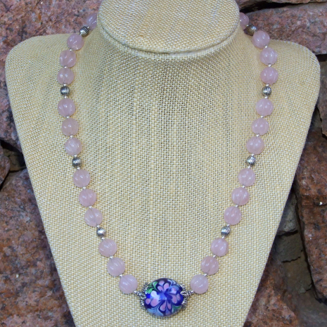 blue and pink flower necklace.