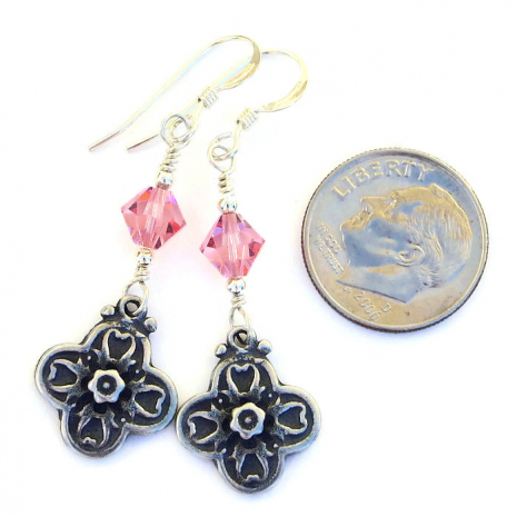 One of a kind flower cross earrings with pink crystals.