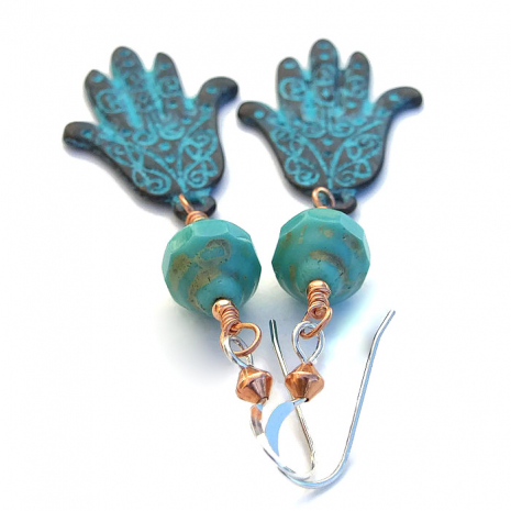 The turquoise colored Czech glass has a rustic finish, perfect with the hamsas