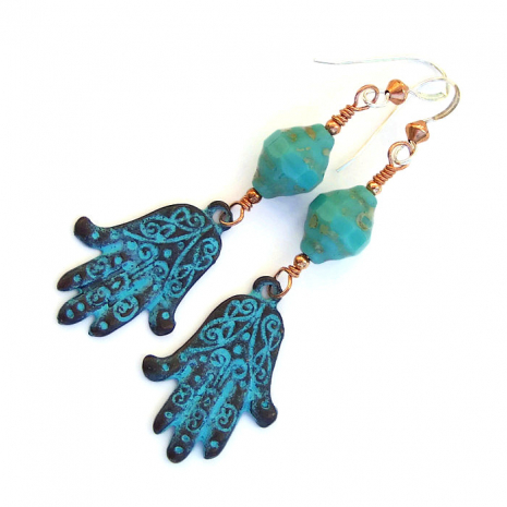 Beautifully detailed Mykonos, Greece, hamsa charms are the focal of the earrings