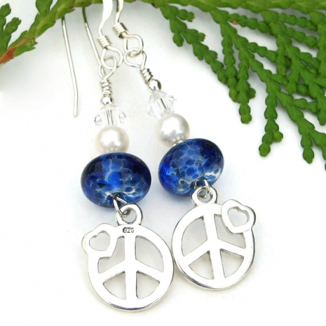 front and back of sterling silver peace sign charms