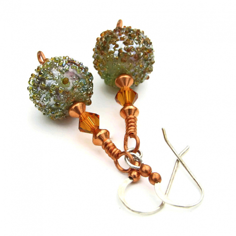 The unique sugared lampwork glass beads were individually artisan made.