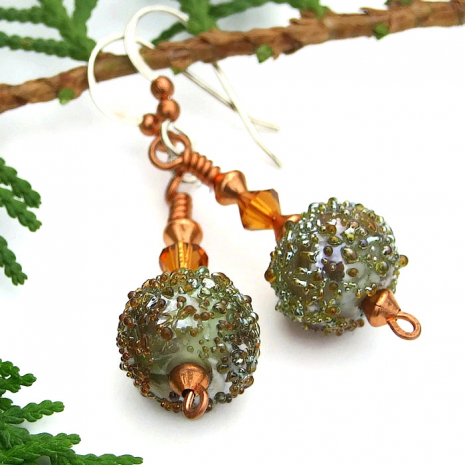 The hand moss green lampwork beads look like they were dipped in sugar.