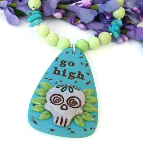 Inspirational Go High sugar skull necklace for women.