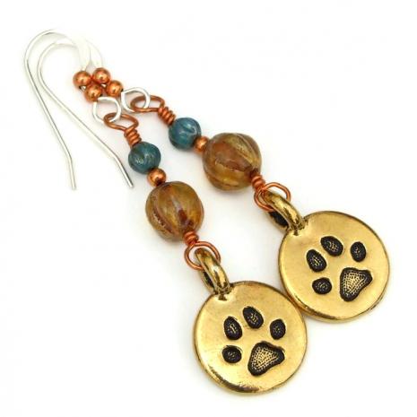gold paw print dangle earrings