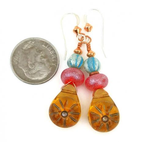 Handmade sun earrings.