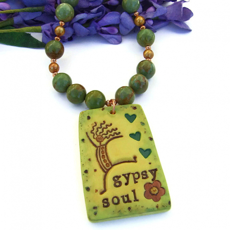 The Gypsy Soul necklace features an artisan polymer clay pendant and turquoise.