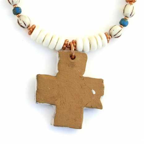 Ceramic cross necklace.