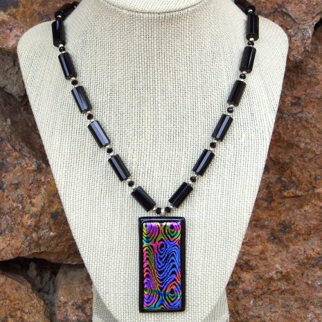 Handmade dichroic glass and black onyx jewelry.