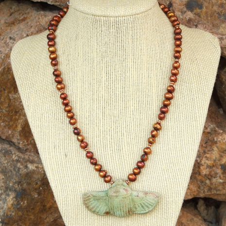 One of a kind pearl necklace featuring a sacred scarab beetle pendant.