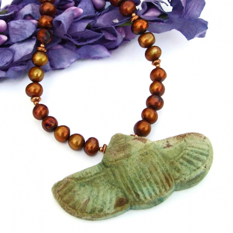 Egyptian faience style sacred scarab beetle pendant, created to look ancient.