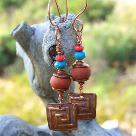 Handmade copper labyrinth squares are the focal of these artisan earrings.