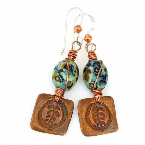 Unique handmade earrings featuring copper leaf charms and organic Czech beads.