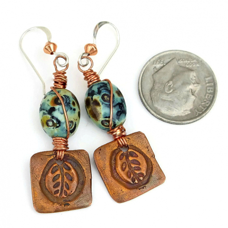 Beautiful earrings with copper leaf charms and mossy Czech glass beads.