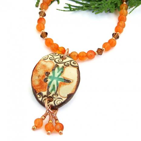 Handmade ceramic dragonfly pendant necklace with gemstones.