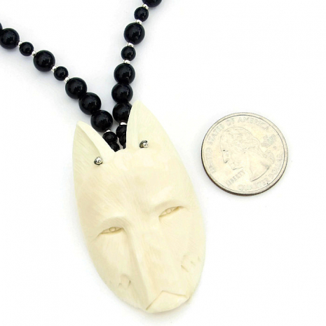 Unique totem wolf head jewelry.