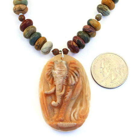 Beautiful carved red malachite pendant necklace with earthy red creek jasper.